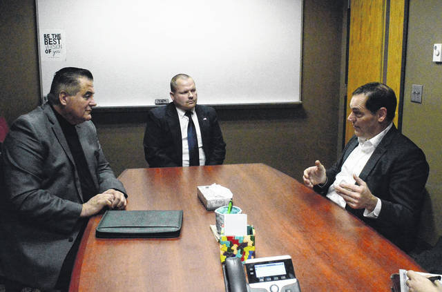 Gallia County Local Schools Superintendent Jude Myers, left, speakers with South Gallia Principal Bray Shamblin, center, and Ohio Auditor candidate and former U.S. Congressman Zack Space, right.