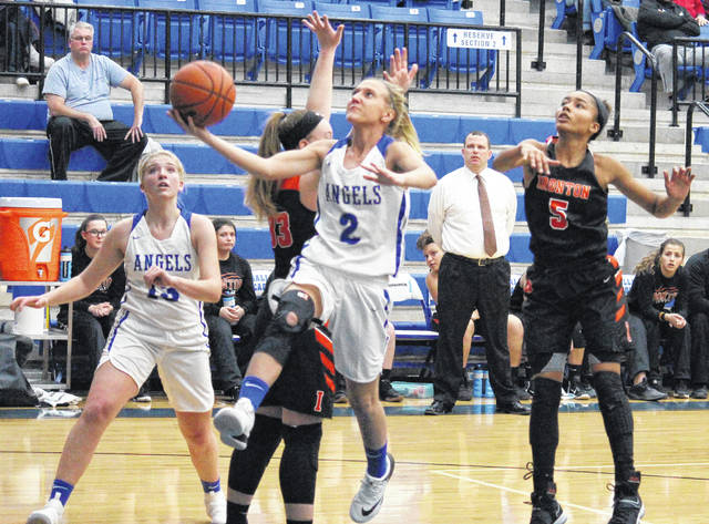 Gallia Academy junior Abby Cremeans (2) slips through the IHS defense for a layup, in front of teammate Maddy Petro (left), during the Blue Angels' 64-41 loss to Ironton on Thursday in Centenary, Ohio.