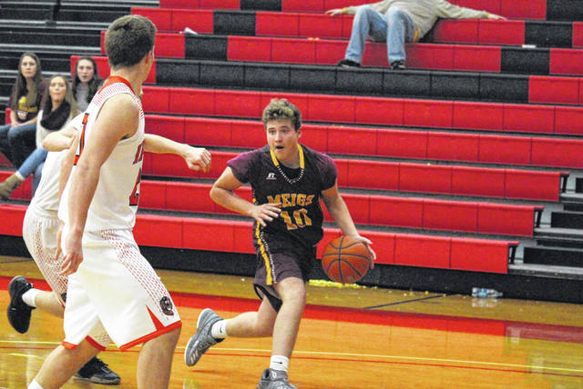 Meigs junior Nick Lilly (10) steps back for a jump shot during the Marauders 40-31 loss to Ironton, in the Newt Oliver Coaches Classic on Saturday in Rio Grande, Ohio.