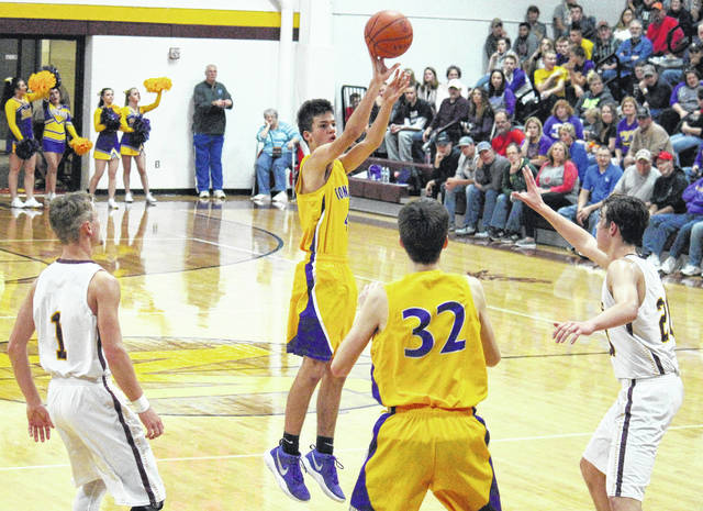 Southern junior Weston Thorla (center) attempts a three-pointer during the Tornadoes' season opening victory on Dec. 2 in Rocksprings, Ohio.
