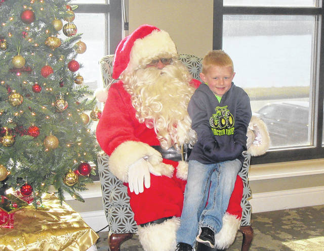 Treyson Mullen visits with Santa on Saturday morning at the Pomeroy Library.