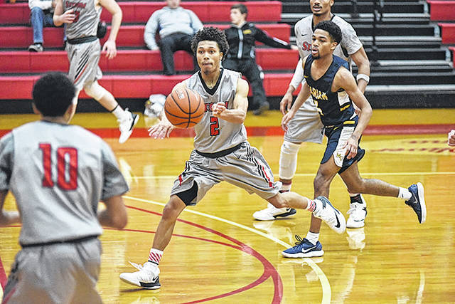 Rio Grande's Will Hill throws a pass during the first half of Saturday's game with Marian University in the 16th Annual Newt Oliver Coaches Classic at the Newt Oliver Arena. Hill scored a career-high 41 points and tied a school record with 10 three-point goals in the RedStorm's 104-90 win over the Knights.