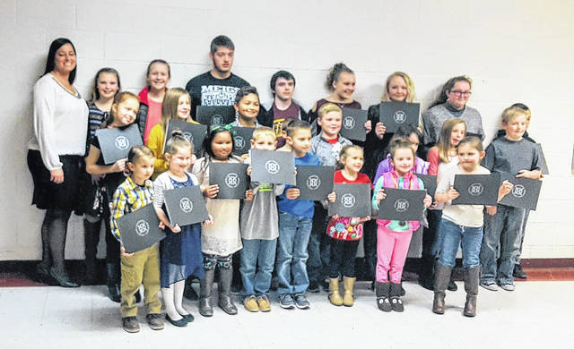 Students of the month in attendance at the recent meeting are pictured with board student achievement liaison Heather Hawley.