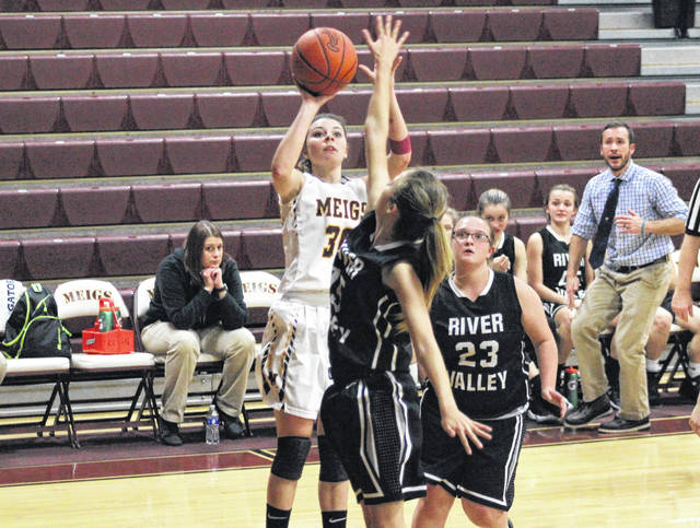 Meigs junior Kassidy Betzing (30) shoots a jump shot in between Lady Raiders Savannah Reese (15) and Kaylee Tucker (23), during the first half of the Lady Marauders' 70-24 victory on Thursday in Rocksprings, Ohio.