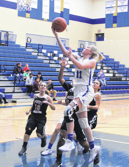 Gallia Academy junior Ashton Webb (11) releases a shot attempt over a trio of Point Pleasant defenders during the second half of Thursday night's non-conference girls basketball contest in Centenary, Ohio.
