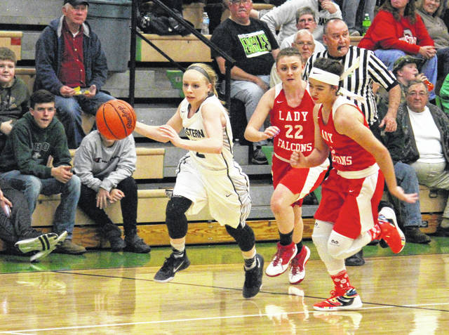 Eastern junior Jess Parker (left) leads Wahama's Elizabeth Mullins (22) and Hannah Rose (right) on a fast break, during the Lady Eagles' 62-26 victory on Monday in Tuppers Plains, Ohio.