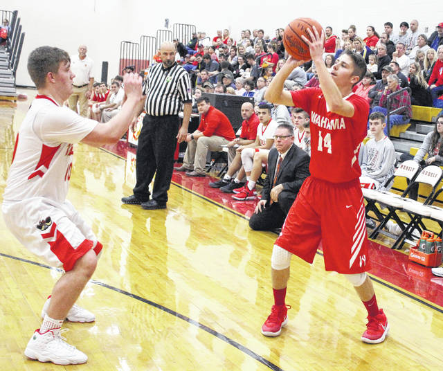 Wahama senior Isaiah Pauley (14) releases a three-point attempt during a Dec. 22 TVC Hocking boys basketball contest against South Gallia in Mercerville, Ohio.