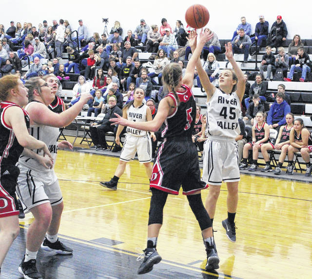 River Valley sophomore Kaylee Gillman (45) releases a shot attempt over an Oak Hill defender during the first half of Thursday night's non-conference girls basketball contest in Bidwell, Ohio.