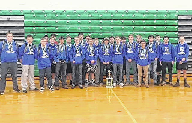 Members of the Gallia Academy wrestling team pose with the first-place trophy following their victory on Saturday in Proctorville, Ohio.