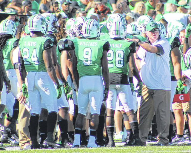 Marshall football coach Doc Holliday, right, gives instructions to his kickoff unit during an Oct. 14 contest against Old Dominion at Joan C. Edwards Stadium in Huntington, W.Va.