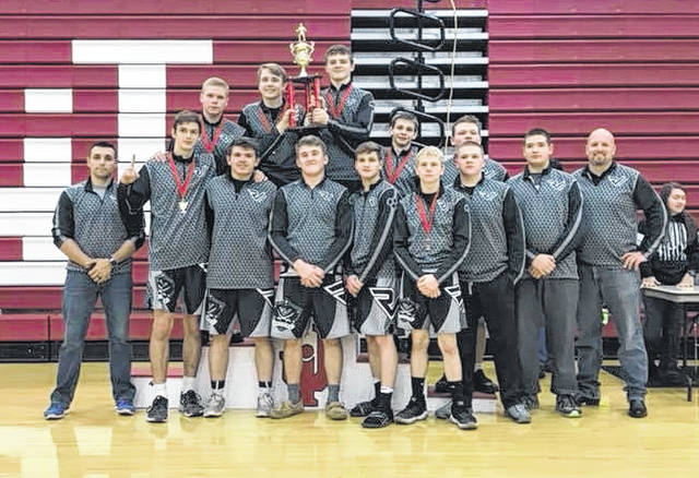Members of the River Valley wrestling team pose for a picture after winning the Jackson American Legion Post 81 Wrestling Invitational held Saturday in Jackson, Ohio.