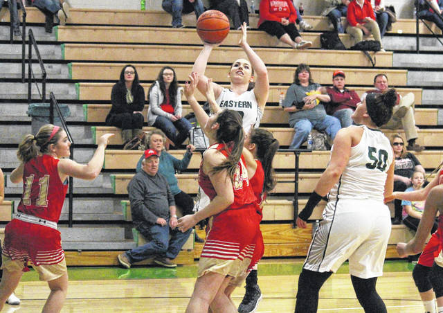 Eastern senior Madison Williams hits a stop-and-pop jumper over a trio of Lady Rebels, during the first half of the Lady Eagles' 60-24 victory on Monday in Tuppers Plains, Ohio.