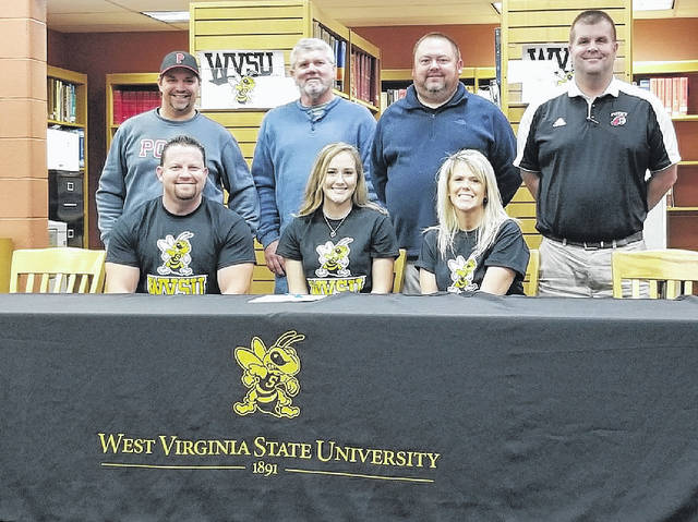 Point Pleasant senior Kelsie Byus, seated front and center, signed a letter of intent to play softball with West Virginia State University on Thursday, Nov. 16, at the PPJSHS library. Kelsie is joined in the front row by her parents, Dave and Lori Byus. Standing in back, from left, are PPHS softball assistant coaches Brian King and Rick Roberts, PPHS head softball coach James Higginbotham and PPHS athletic director Kent Price.