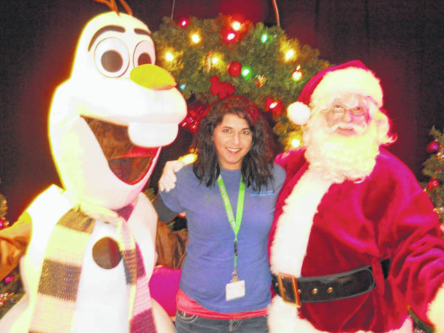 Service coordinator at Meigs County Early Intervention Katie Anderson with Santa and Olaf.