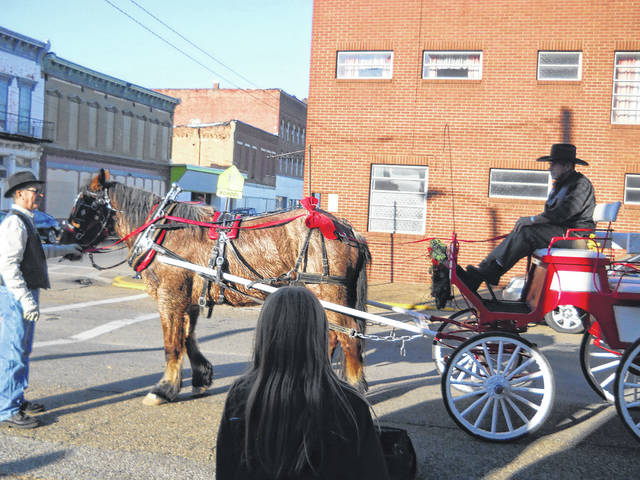 Free carriage rides by Mike Roach and company.