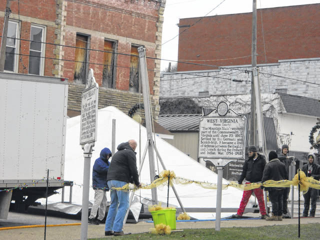 Workers begin setting up a tent on Wednesday for Friday's Silver Bridge Memorial. At least three ceremonies will be held on Friday to observe the 50th anniversary of the Silver Bridge Collapse.