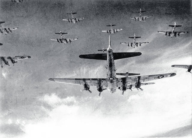 A group of B-17s flying to war.