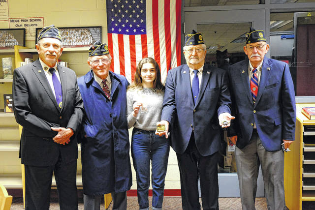 Drew Webster Post #39 of the American Legion in Pomeroy recently gave its annual Americanism Test to students at Meigs High School. Participating in the testing was Leila Ashirova, a foreign exchange student from the Republic of Georgia. Following the testing, she presented the Legion members in attendance with several mementos from her country. Pictured are Wayne Thomas, Mick Williams, Leila Ashirova, Wally Hatfield, and Sam VanMatre.