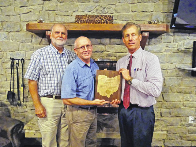 The Meigs Soil and Water Conservation District in October received the Abandoned Mine Land Reclamation Award for 2017 from the Ohio Department of Natural Resources-Division of Mineral Resources Management. Shown are, from left: Steve Jenkins, Meigs SWCD Program Administrator, Jim Freeman, Meigs SWCD Wildlife Specialist/Watershed Coordinator, and ODNR-DMRM Chief Lanny E. Erdos.