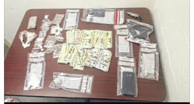 Items seized following a search warrant executed at a home on Mill Street on Saturday.