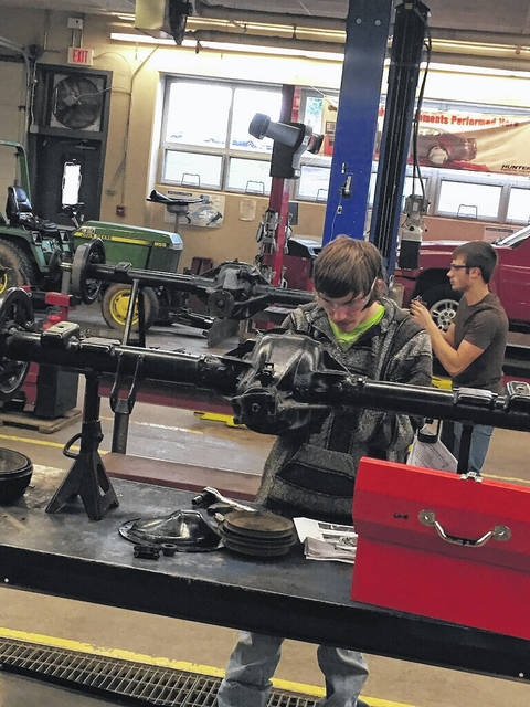 An auto student working on a class assignment.