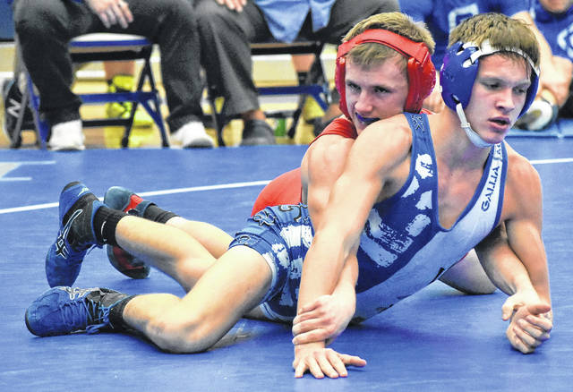 South Gallia sophomore Jacob Birtcher, top, gains leverage on Gallia Academy's Tristin Crisenbery during a 138-pound match on Wednesday night at Gallia Academy High School in Centenary, Ohio.