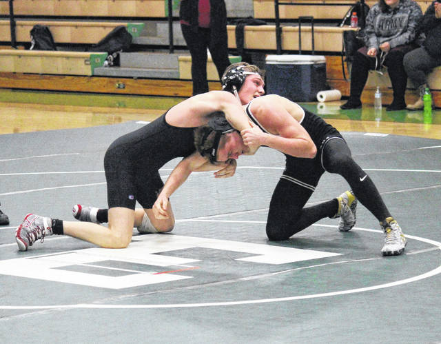 Meigs sophomore Tucker Smith (left) and Eastern junior Dillon Aeiker (right) grapple in the 138-pound bout, during a tri-match on Thursday in Tuppers Plains, Ohio.