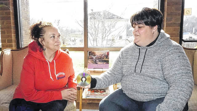 Angie Fletcher, left, and Ami Williams are pictured as they talk about their upcoming trip to the Grammy Awards in New York City, and their favorite musical artists. Williams won an all-expense paid trip to the awards in a contest sponsored by WOWK-TV, which will air the Grammys on Sunday evening.