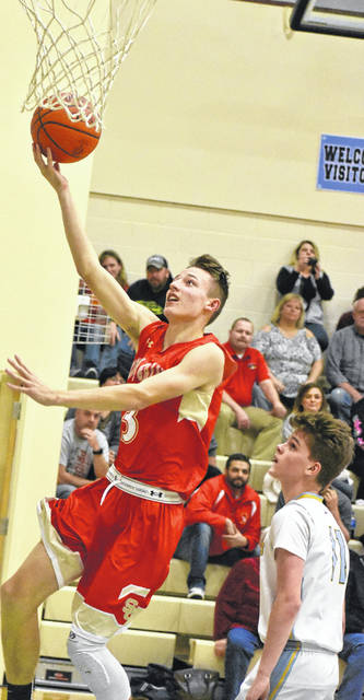 South Gallia sophomore Jared Burdette attempts a lay up during the second half of the Rebel's win over Ohio Valley Christian on Thursday night in Gallipolis, Ohio.
