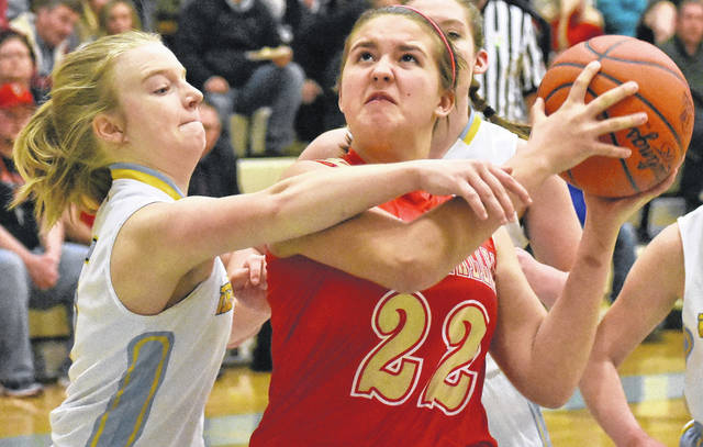 South Gallia freshman Makayla Waugh (22) attempts to drive the lane against a Ohio Valley Christian defender during Thursday night's girls varsity basketball game in Gallipolis, Ohio.