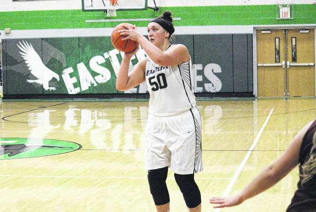 Eastern senior Elizabeth Collins (50) lines up a successful three-pointer during the first half of the Lady Eagles' 71-70 victory on Wednesday in Tuppers Plains, Ohio.