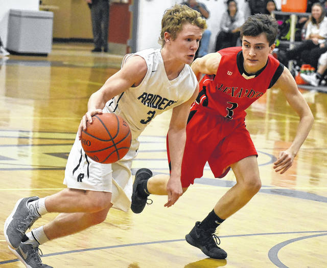 River Valley junior Rory Twyman (3) attempts to drive toward the basket against an Alexander defender during Friday night's boys varsity basketball contest in Bidwell, Ohio.