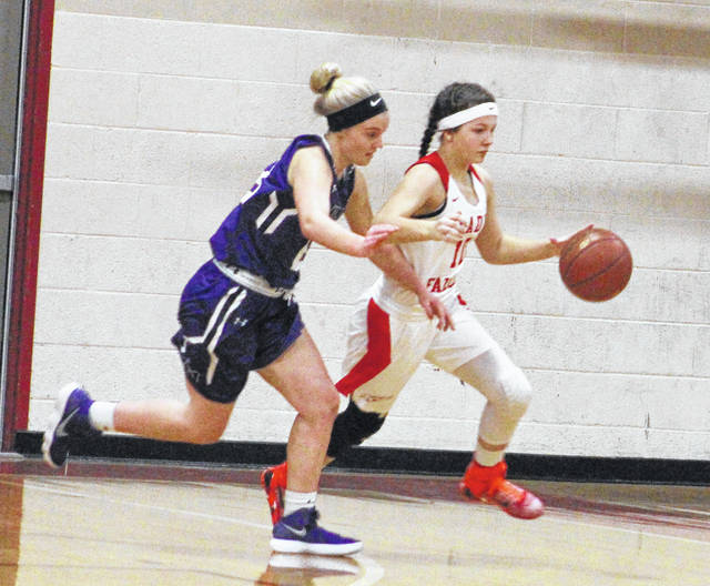 Wahama junior Ashtyn Russell dribbles the ball past a Miller defender during the first half of Thursday night's TVC Hocking girls basketball contest in Mason, W.Va.
