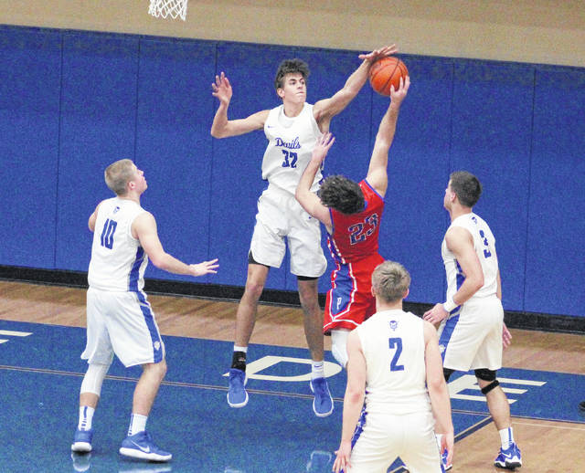 Gallia Academy sophomore Zach Loveday (32) blocks a shot during the second half of Saturday night's OVC boys basketball contest against Portsmouth in Centenary, Ohio.