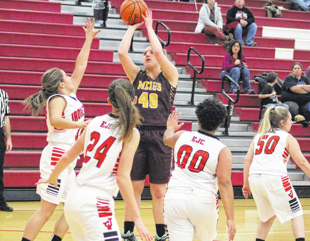 Meigs seniot Devin Humphreys (40) releases a shot attempt over a Jackson defender during the second half of Thursday night's girls basketball contest in Jackson, Ohio.