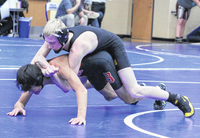 Meigs freshman Griffin Buck locks in a hold on a Belpre opponent during a 106-pound match at the Skyline Bowling Invitational held Dec. 30, 2017, at Gallia Academy High School in Centenary, Ohio.