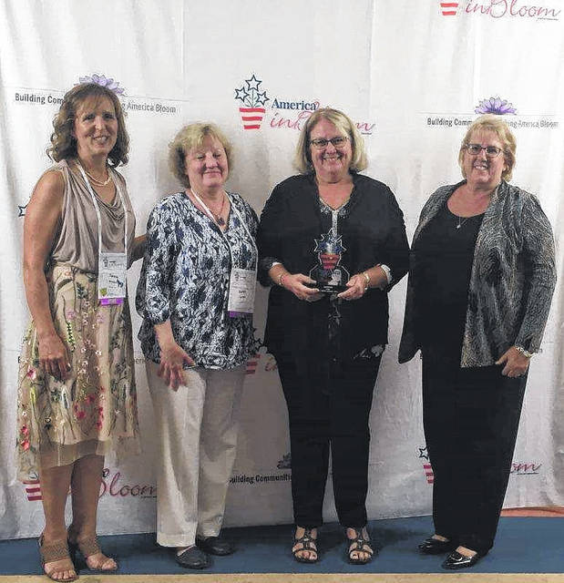 From left to right, America in Bloom Judges Teresa Woodard and Karin Rindal stand with Gallipolis in Bloom representatives Bev Dunkle and Kim Canaday during the America in Bloom Symposium and Awards Celebration in Holliston, Mass., 2017