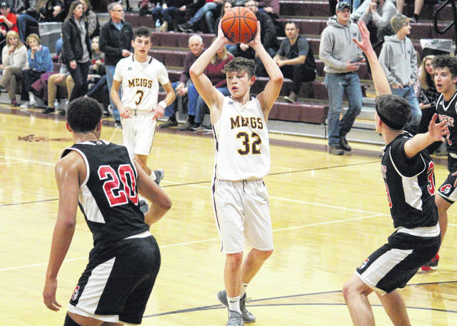 Meigs freshman Wyatt Hoover (32) looks to pass from the top of the key, during the first half of the Marauders' 61-58 victory on Tuesday in Rocksprings, Ohio.