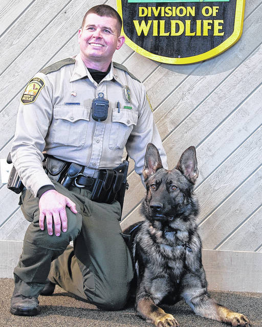 Wildlife Officer Chris Gilkely with his canine partner Mattis.