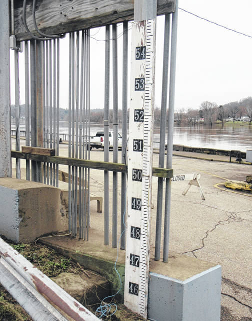 The river level marker on the Pomeroy Parking Lot will once again be closely monitored as the Ohio River returns to the streets of Pomeroy.