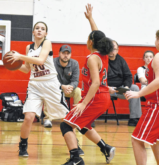 Point Pleasant freshman Kenly Arbogast (30) attempts to shoot against a Wayne defender during the second half of Tuesday night's 52-22 loss in Point Pleasant, W.Va.