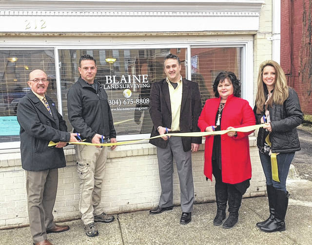 """Blaine Surveying, PLLC, has opened an office located at 212 5th Street in Point Pleasant. Blaine Surveying, PLLC began providing professional services to the people of western North Carolina in September of 2004. Since then, they have expanded into the Colorado and West Virginia markets as well. The company has a mission statement """"to provide accurate, reliable, and affordable land surveying and mapping services to promote and protect the welfare of the general public."""" Pictured at the ribbon cutting for the 5th Street location are Mayor Brian Billings, Nate Blaine, Jon Blaine, Councilwoman Elizabeth Jones and City Clerk Amber Tatterson. Call 304-675-8808 or email jon@blainesurveying.com for more information. Also, find them on Facebook and online."""