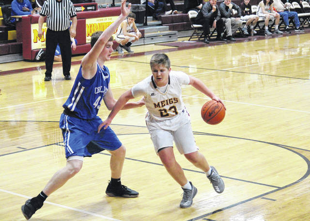 Meigs sophomore Austin Mahr (23) drives against Chillicothe's Brandon Noel (left), during the Cavaliers' 77-52 victory on Tuesday in Rockspings, Ohio.