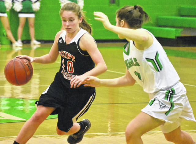 Point Pleasant junior Allison Henderson attempts to drive past a Lady Generals defender during the second half of Monday night's 73-33 loss to Winfield in Winfield, W.Va.