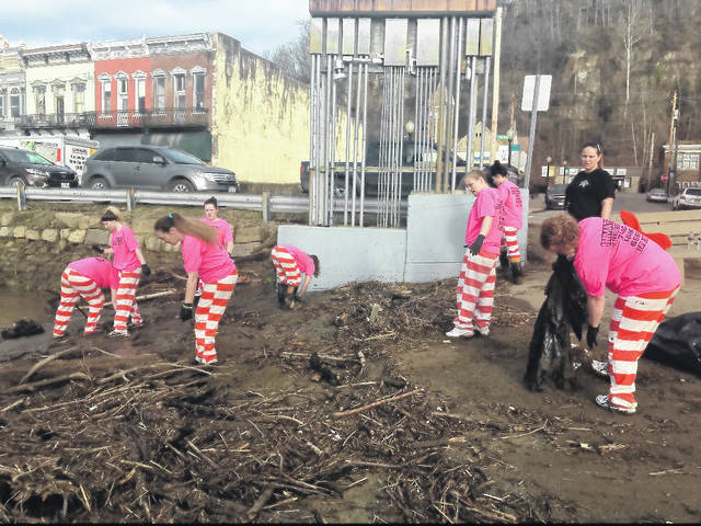 Inmates from the Gallia County Work Release Center worked to clean up from the recent flooding in Pomeroy on Wednesday.