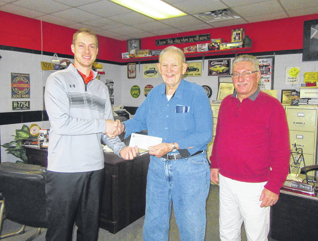 J.B. Brunner of ASC Warranty Company presents a donation to Bob Mills from the First Southern Baptist Church to be used for the church's jail ministry program. Also pictured is Rocky Hupp of Hupp Auto Center.