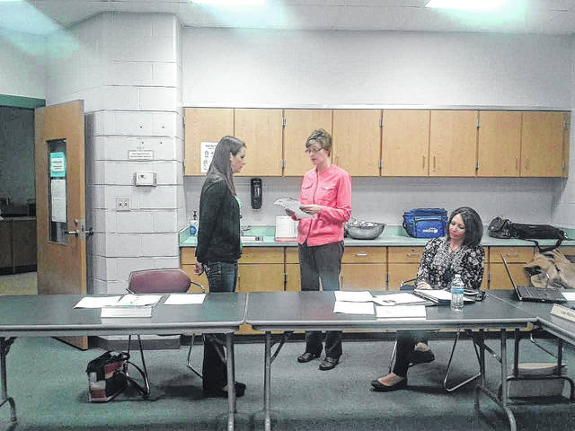 Jessica Staley takes the oath of office administered by Treasurer Lisa Ritchie.