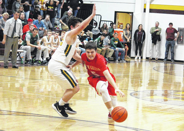 South Gallia senior Curtis Haner (5) drives past an Eastern defender en route to the game-winning shot of the Rebels' 57-55 victory in the Division IV sectional semifinal on Wednesday at Meigs High School in Rocksprings, Ohio.