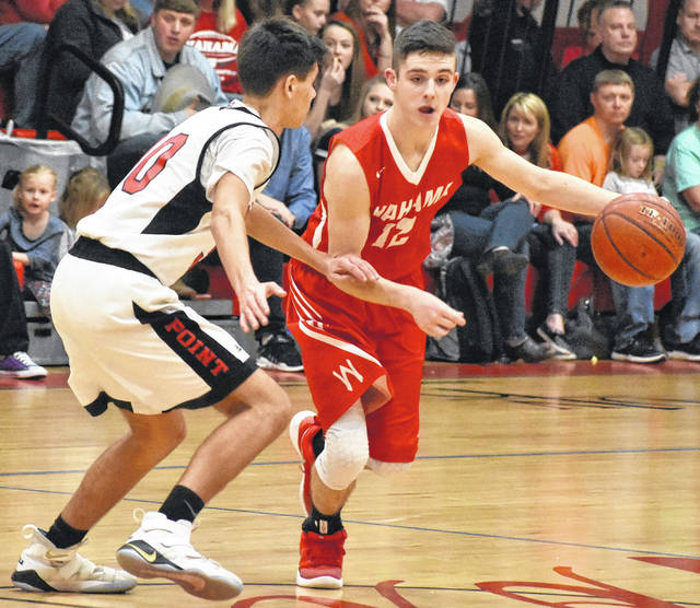 Wahama sophomore Abram Pauley (12) drives the ball against a Point Pleasant defender during the second half of the White Falcons 55-50 overtime victory on Wednesday night at The Dungeon in Point Pleasant, W.Va.