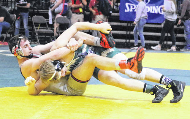Point Pleasant senior Clayton Hill locks in a hold on an opponent during a Class AA-A 182-pound match held Thursday night at the 2018 WVSSAC Wrestling Championships at Big Sandy Superstore Arena in Huntington, W.Va.